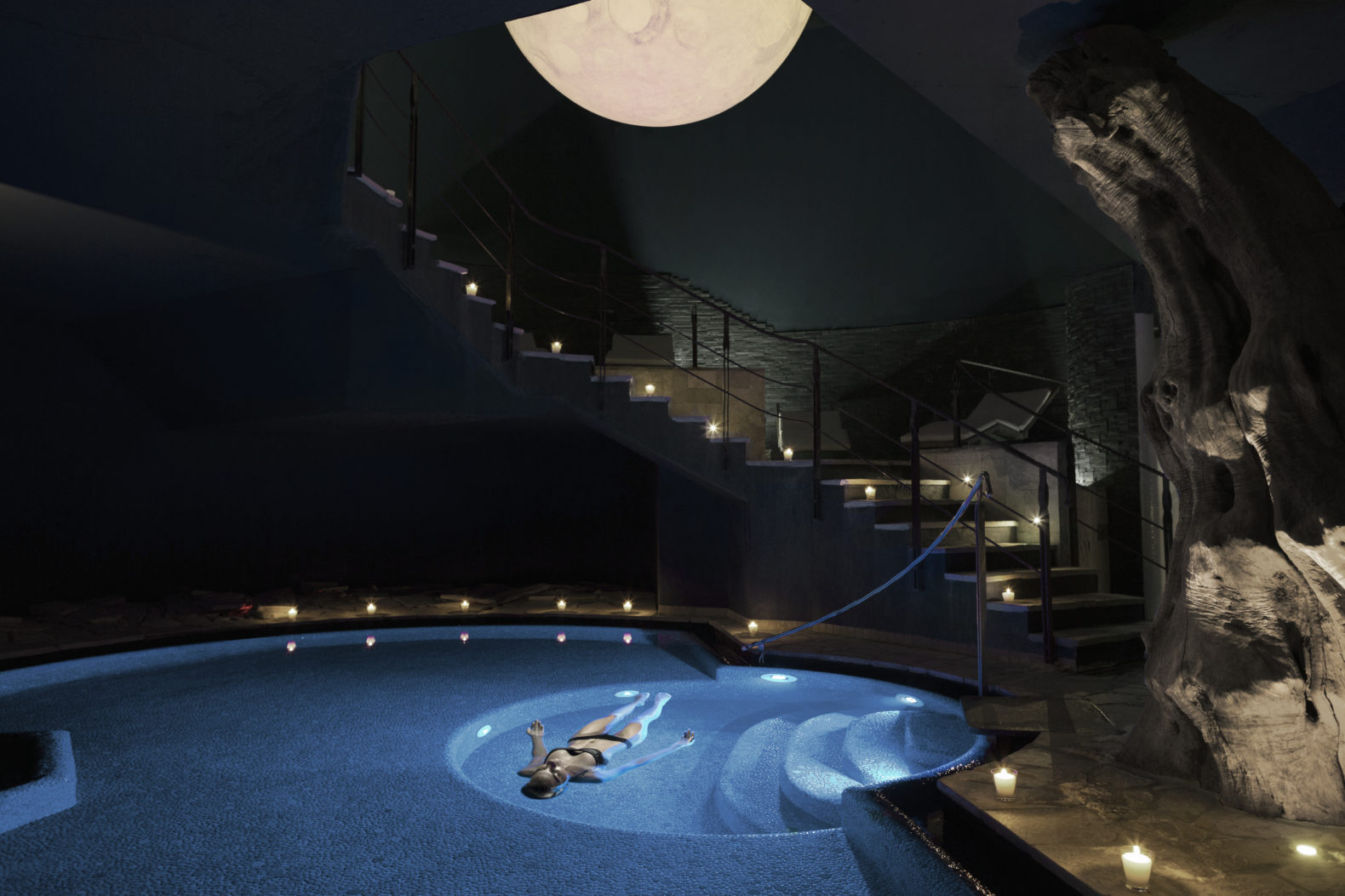 indoor-pool-salt-water-lake-woman-floating-experience-adventure-candlelight-lefay-resorts-lago-di-garda-italy