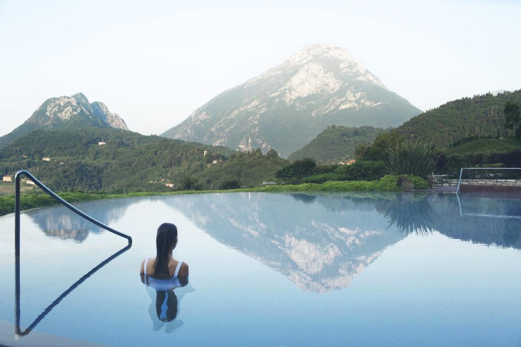 pool_ indoor-outdoor-woman-swimming-sports-mountain-energy-lefay-resorts-lago-di-garda-italy