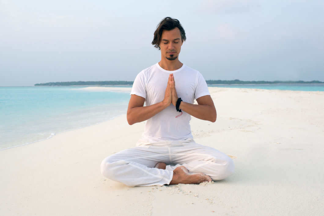 morning-meditation-sand-bank-soneva-fushi-hotel-maldives