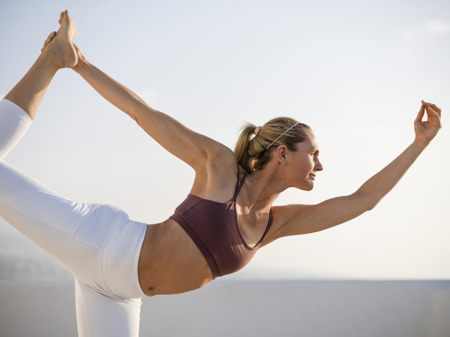 woman-doing-yoga-rooftop-ocean-air-meditation-oceano-hotel-health-spa-tenerife-spain