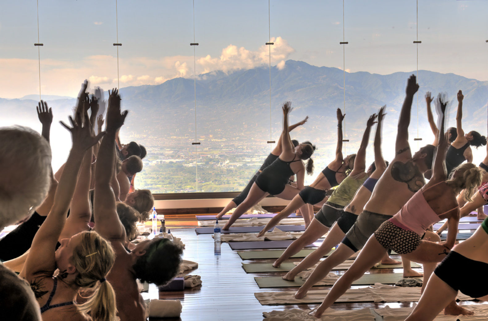 group-yoga-class-stretching-breathing-mountain-air-panorama-view-scenery-pura-vida-retreat-spa-costa-rica