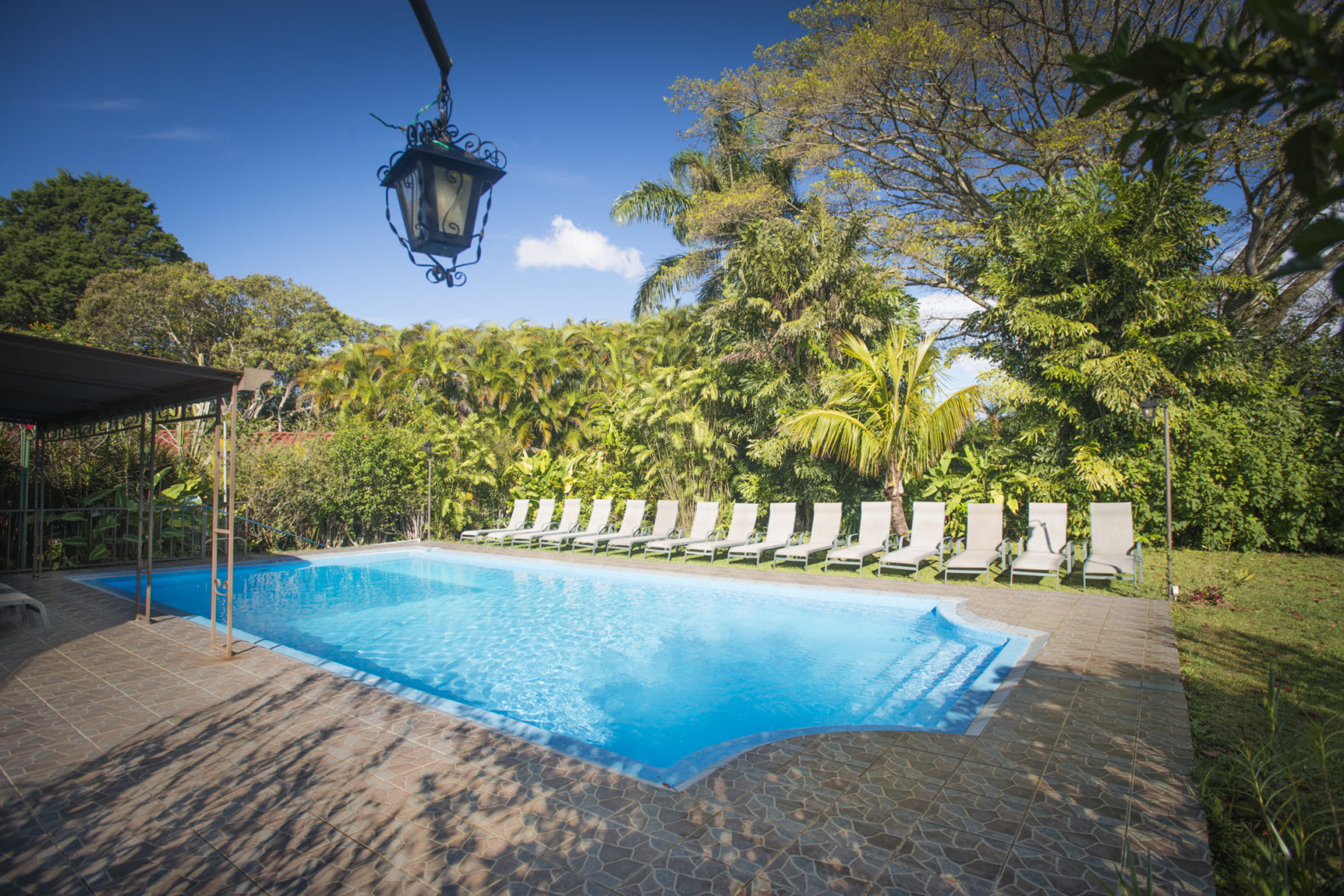 swimming-pool-outdoor-sports-activities-natural-surrounding-sunbeds-pura-vida-retreat-spa-costa-rica-1.jpg