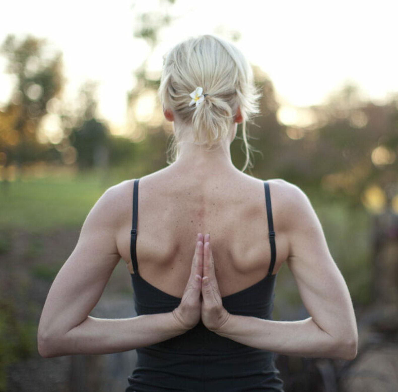 woman-yoga-arm-stretching-outside-samadhi-health-wellness-retreat-australia