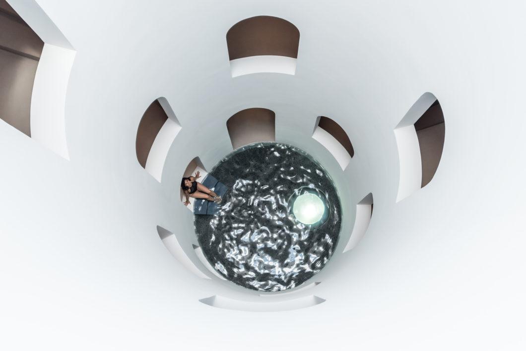 sphere-pool-woman-sitting-inside-relax-experience-euphoria-retreat-greece