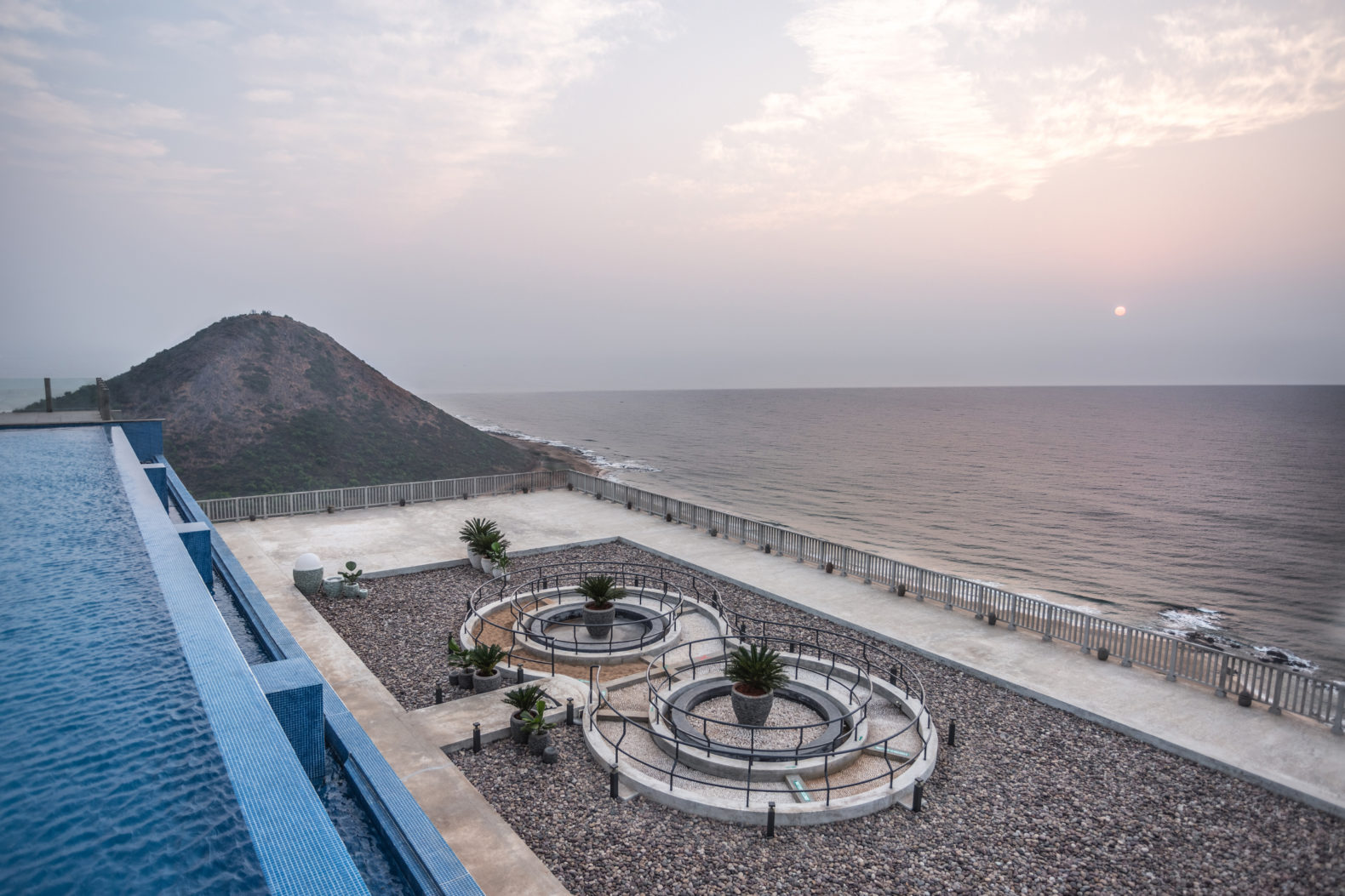 garden-view-natural-stones-infinity-pool-ocean-waves-moonshine-pema-health-healing-resort-india-hotel