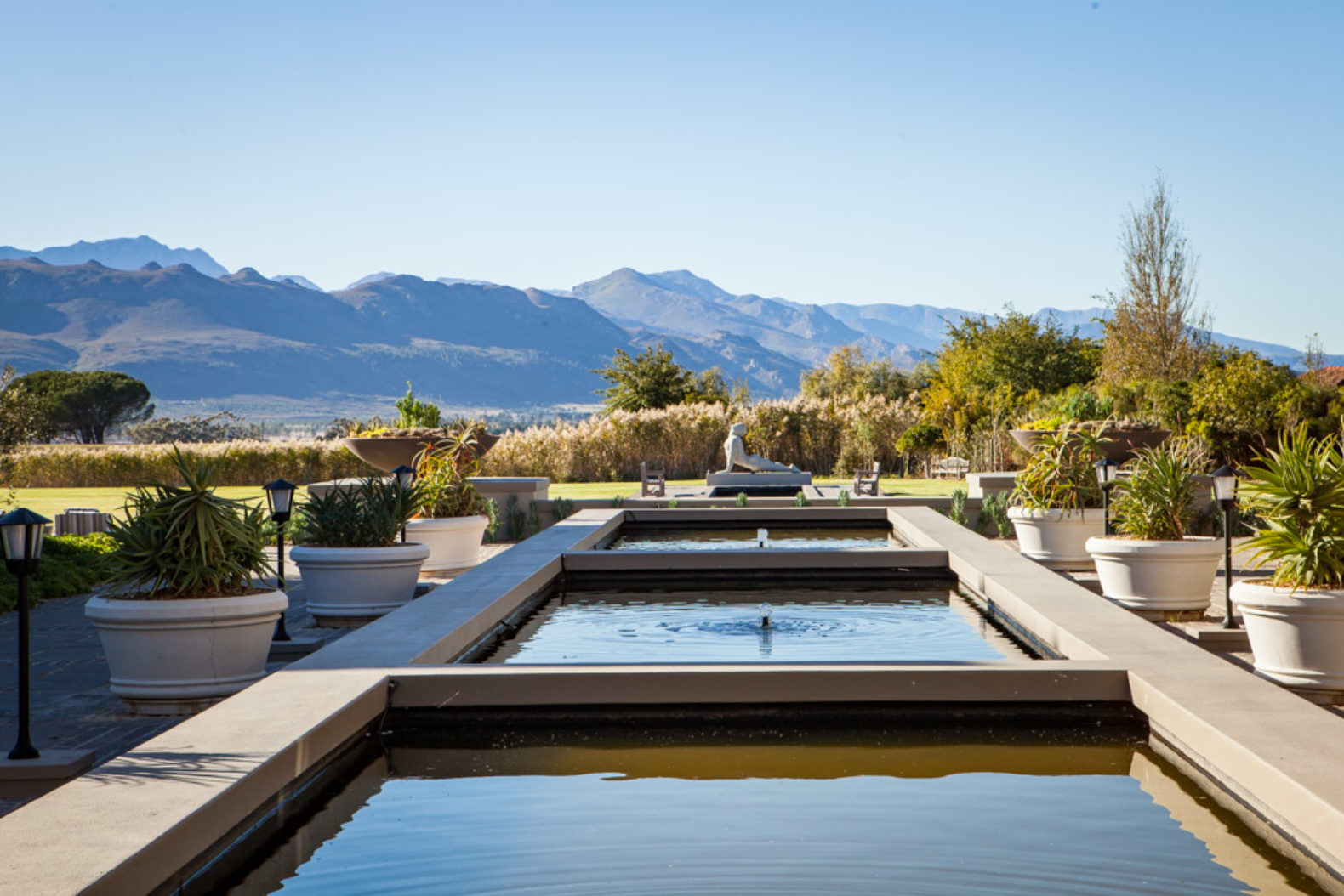 landscape-view-fountain-pond-statue-sante-wellness-retreat-spa-hotel-southafrica