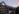 outside_view_nature_building_lake_mountains_lefay_resort_spa_dolomiti_italy
