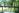 man-reading-bridge-river-green-scenery-plants-relax-laphina-spa-brazil